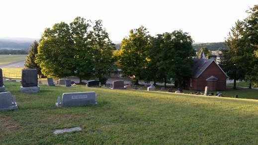 Cemetery overlooking runway of http://elkinsairport.com/