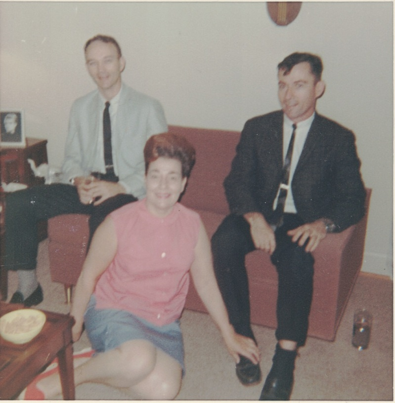 "l to r: Mike Collins (Apollo 11), Myrtle ""Jay"" Jenzano, and John Young (Apollo 16) in the Jenzano living room, ca. 1964. Image courtesy of Carol Jenzano, copyright 2018."